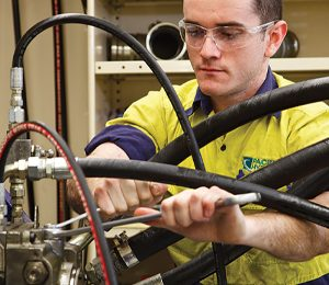 Man repairing hydraulic systems
